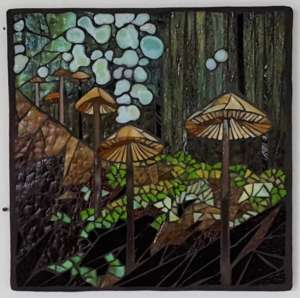 Glass mosaic of mushrooms on forest floor