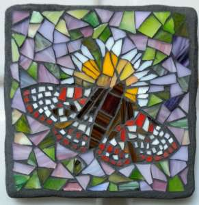 Glass Mosaic of butterfly on flower