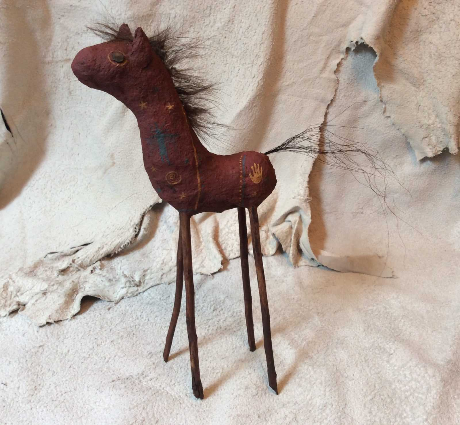 horse sculpture with sticks and recycled objects