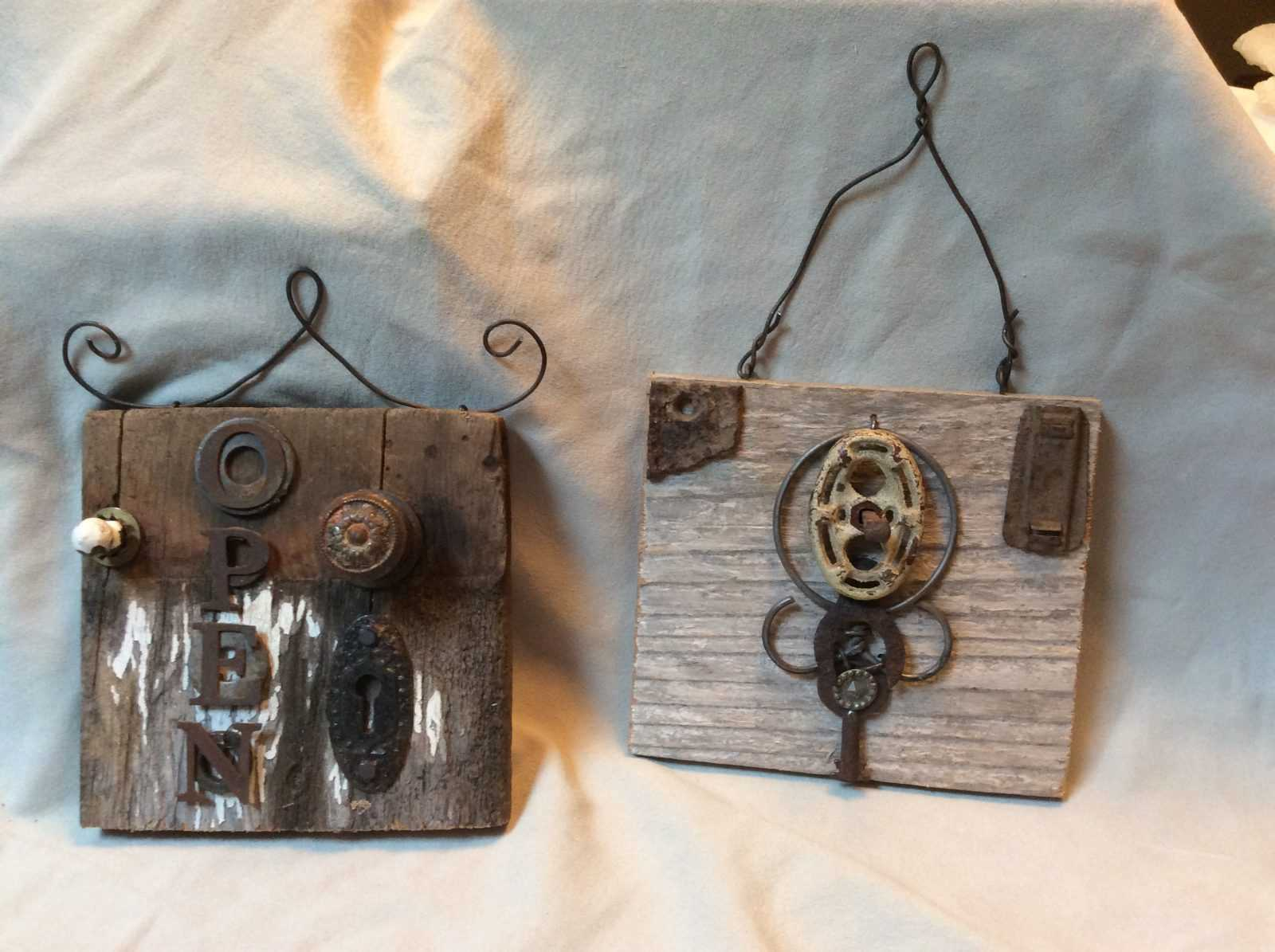 repurposed wall hangings on board