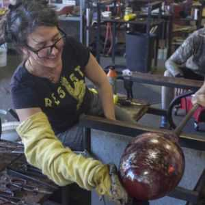 kelly Howard making Glass art with team