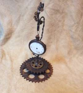 repurposed sculpture with pocket watch and cogs